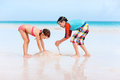Two kids playing with sand Stock Photo