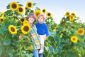 Two kids playing in a sunflower field on sunny day Royalty Free Stock Photo