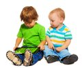 Two kids playing tablet Royalty Free Stock Image