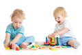 Two kids playing wooden toys sitting together concentrated child logical education with great interest on white background Royalty Free Stock Image