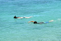 Two kids snorkeling, Big Island, Hawaii Royalty Free Stock Photo