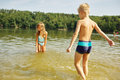 Two kids splashing water bathingn and with the in summer Royalty Free Stock Image