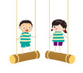 Two kids swinging on swings Royalty Free Stock Photography