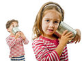 Two kids talking on a tin phone Royalty Free Stock Photo
