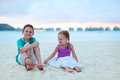 Two kids at tropical resort beach vacation Stock Images