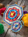 Two knitted tibetan mandala from threads and yarn selective foc on table focus Royalty Free Stock Image