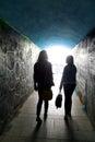 Two ladies in the tunnel silhouette access to beach from promenade lungo mare opatija riviera adriatic sea croatia istria Stock Image
