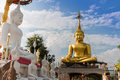 Two large statues of buddha concentrate on clouds and sky Stock Image