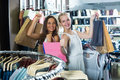 Two laughing girls having many shopping bags Royalty Free Stock Photo