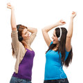 Two laughing girls with headphones dancing Royalty Free Stock Photo