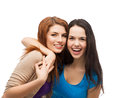 Two laughing girls hugging friendship and happy people concept Stock Image