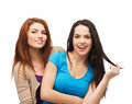Two laughing girls hugging friendship and happy people concept Royalty Free Stock Image