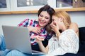 Two laughing girls watching movie Royalty Free Stock Photo
