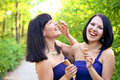 Two laughing women with ice cream in the summer park Royalty Free Stock Photography