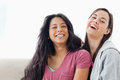Two laughing women looking towards the camer Stock Photo