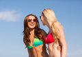 Two laughing young women on beach Royalty Free Stock Photo