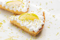 Two lemon pie slices in withe dish Royalty Free Stock Image