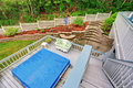 Two level backyard deck with jacuzzi on the first floor and patio area on the second one Royalty Free Stock Photo