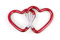 Two linked heart shaped carabiner red color Stock Photo