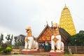 Two lion guard statues in thai temple sangklaburi kanchanaburi thailand Stock Images