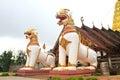 Two lion guard statues in thai temple sangklaburi kanchanaburi thailand Stock Photography