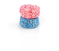 Two liquorice allsorts candy isolated on white background round one pink and one blue Royalty Free Stock Photo