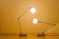 Two lit modern lamps Royalty Free Stock Photo