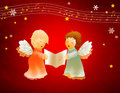 Two little angels sing Royalty Free Stock Photography