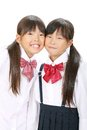 Two little asian schoolgirls Stock Photo