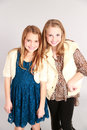 Two little blonde girls smiling fashion shot of beautiful young Royalty Free Stock Photos