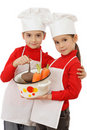 Two little chief-cookers holding a pot Royalty Free Stock Photo