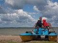 Two little children on a catamaran observing nature Royalty Free Stock Photo