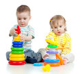 Two little children playing with color toys Royalty Free Stock Photography