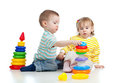 Two little children playing with color toys Stock Image