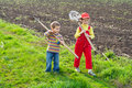 Two little children walking with tools Royalty Free Stock Image