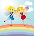Two little fairies in the rainbow Royalty Free Stock Photo