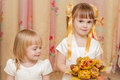 Two little girl with bouquet of autumn leaves Stock Photo