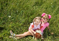 Two little girl in green grass. Royalty Free Stock Photo