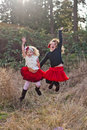 Two little girls dancing outdoors Royalty Free Stock Photo