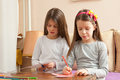 Two Little Girls are Drawing Colorful Hearts