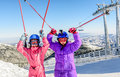 Two little girls enjoying skiing on Kopaonik, Serbia Royalty Free Stock Photo