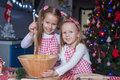 Two little girls make gingerbread cookies for Royalty Free Stock Photo