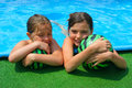 Two little girls playing in the bassin Stock Images