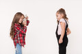 Two little girls taking a picture of each other