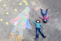 Two little kid boys flying by a space shuttle chalks picture Royalty Free Stock Photo