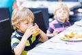 Two little kid boys having healthy breakfast in hotel restaurant Royalty Free Stock Photo