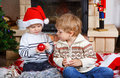 Two little sibling boys being happy about christmas present playing with toys indoor with decoration Stock Image