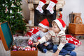 Two little sibling boys being happy about christmas present playing with toys indoor with decoration Royalty Free Stock Image