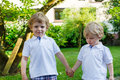 Two little sibling boys having fun outdoors in family look summer Stock Photos