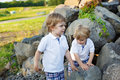 Two little sibling boys having fun outdoors in family look summer Stock Photography